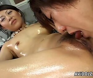 Oil covered titless whore turns erotic massage into cock sucking